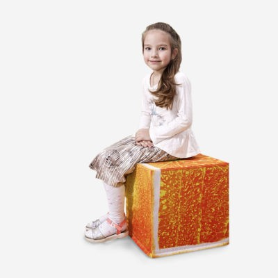 Girl is sitting on orange cube