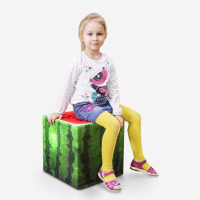 girl sitting on watermelon cube