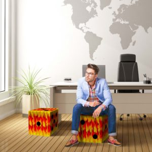 man sitting on a hot dice cube