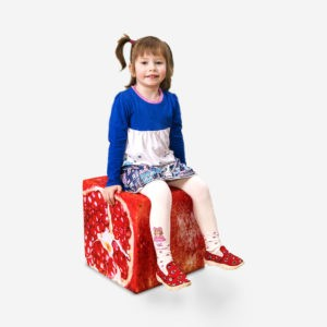 Girl is sitting in Pomegranate cube